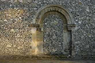 Kingsclere - Filled in Norman, (c. 1130–1140), northern doorway of St. Mary's church. (Flint re-facing is c1848).
