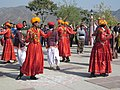Folk dancers dancing and plying with each others. - panoramio.jpg
