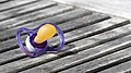 Forgotten pacifier on a table in Röe gård cafe.jpg