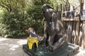 Four-year-old Lily Macey supplants an (albeit statuary) elephant from its stool at the Houston, Texas, zoo LCCN2014633252.tif