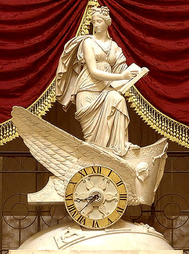 Carlo Franzoni's 1810 sculptural chariot clock, the Car of History depicting Clio, muse of history, recording the proceedings of the house FranzoniClock.jpg