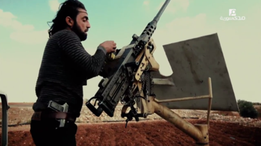 An FSA fighter loads a US-made M2 Browning heavy machine gun in northern Aleppo, November 2016. Free Syrian Army M2 Browning in northern Aleppo.png