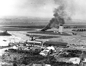 Operation Frequent Wind - RVNAF C-130A burns at Tan Son Nhut after rocket attack on 29 April