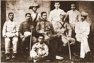Philippine Revolutionary Army - Group showing General Manuel Tinio (seated, center), General Benito Natividad (seated, 2nd from right), Lt. Col. Jose Alejandrino (seated, 2nd from left), and their aides-de-camp.
