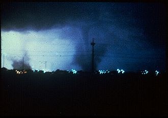 1980 Grand Island tornado outbreak - In this picture, there are two independent tornadoes on the ground marked by large debris clouds at ground level and are located a few hundred yards away from one another. The smaller tornado on the left is the first F1 to hit Grand Island. The 0.25 mile-wide tornado on the right is the second F3 to hit. Power flashes from electrical lines being destroyed by the ferocious winds illuminate the nighttime tornadoes.