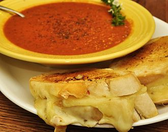 Tomato soup served with a grilled cheese sandwich Grilled cheese sandwich with roasted tomato soup.jpg