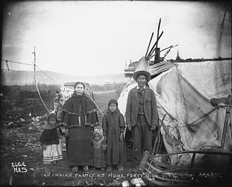 Gwich'in - Gwich'in family outside their home, c. 1899