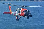 HH60 Retrieving rescue swimmer