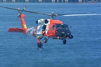Sikorsky MH-60 Jayhawk - A Jayhawk retrieves a rescue swimmer.