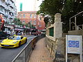 HK Mid-levels Bonham Road HKU campus sign n sidewalk Jan-2016 yellow race car King's College school building.JPG