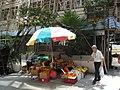 HK Sheung Wan Kom U Street stall visitors sun beach umbrella Queen's Road West Sept-2012.JPG
