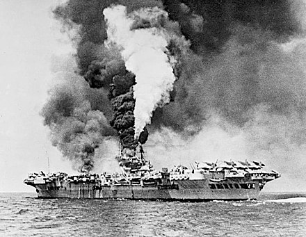 Aircraft carrier HMS Formidable after being struck by a kamikaze off the Sakishima Islands. The kamikaze made a dent 3 metres (9.8 ft) long and 0.6 metres (2 ft 0 in) wide and deep in the armored flight deck. Eight crew members were killed, forty-seven were wounded, and 11 aircraft were destroyed. HMS Formidable (67) on fire 1945.jpg