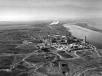 William F. Brown - Nuclear reactors line the riverbank at the Hanford Site along the Columbia River in January 1960.