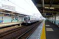 Higashimukojimastationplatforms-train-april28-2015.jpg
