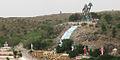 Hill in Prashanthi Nilayam with statues of Hanuman, Krishna, Shirdi Sai Baba, Shiva, Buddha, Christ, Zarathustra.jpg