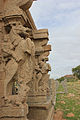 Horse pillars at entrance to water tank in Hampi.JPG