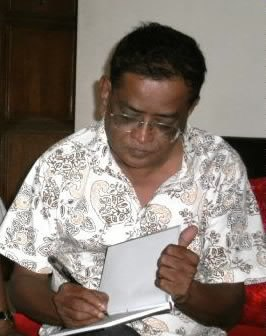 Humyun ahmed signing a book