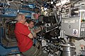 ISS-22 Jeffrey Williams and T.J. Creamer work the controls of the Canadarm2 in the Destiny lab.jpg