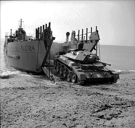A Crusader I tank emerges from the Tank Landing Craft TLC-124, 26 April 1942 IWM-H-19057-Crusader-landing-19420426.jpg