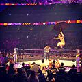 Jack Gallagher jumps off the turnbuckle with an umbrell, WWE 205 Live, April 4, 2017.jpg