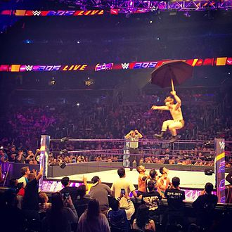 """Gentleman Jack Gallagher - Gallagher jumps off the turnbuckle with an umbrella he calls """"William III""""."""