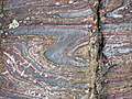 Jaspilite banded iron formation (Soudan Iron-Formation, Neoarchean, ~2.69 Ga; Stuntz Bay Road outcrop, Soudan Underground State Park, Soudan, Minnesota, USA) 32 (19199632806).jpg