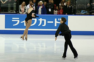 Figure skating jumps - A throw jump in mid-air