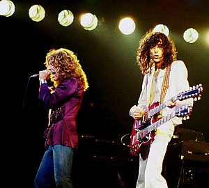 "Led Zeppelin North American Tour 1977 - Page (right) and Plant (left) on stage during the 1977 North American Tour at Chicago Stadium on April 10, 1977, performing ""Stairway to Heaven""."