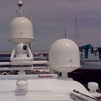 Radome - A yacht fitted with small KNS tracking dishes for SES Broadband for Maritime, protected by radomes