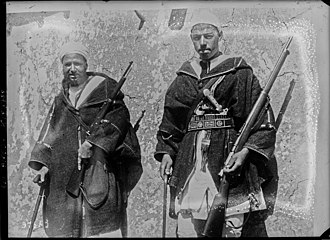 Berbers carrying captured rifles. A Spanish Mauser and a French Berthier Carbine. Kaid Sarkash (Riffian leader) 1924.jpg