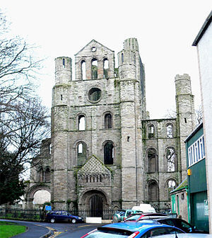 Kelso Abbey - The north transept of the west crossing, showing the north doorjamb and full gable flanked with massive columnar towers.