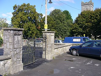Newcastle Emlyn - The entrance to King George's Field in Church Lane, Newcastle Emlyn, Carmarthenshire. Holy Trinity Church is in the background on the right.
