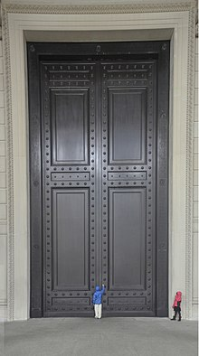 The Bronze Doors Of The National Archives Building In Washington, D.C..  Each Is 37 Ft 7 In (11.5 M) Tall And Weighs Roughly 6.5 Short Tons (5.9 T)