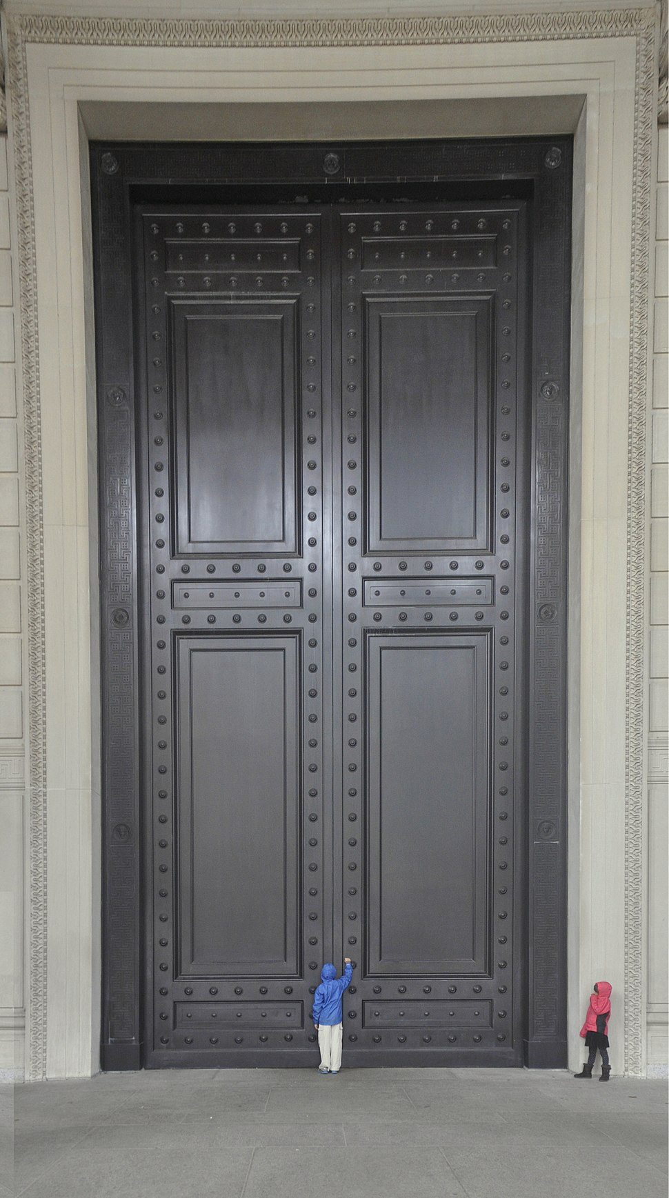 Knocking at front door of The National Archives Building - 01