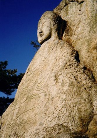 Korean Buddhism - A stone image of a Buddha, near Gyeongju, South Korea. 7th century Silla.