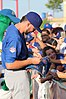 Kris Bryant signing autographs during his rehab assignment against Omaha (43598147994).jpg