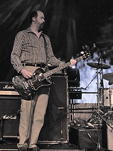 Novoselic playing bass guitar onstage