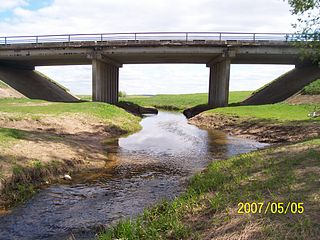 The river Lankesa at the Nartautai-Zeimiai road bridge