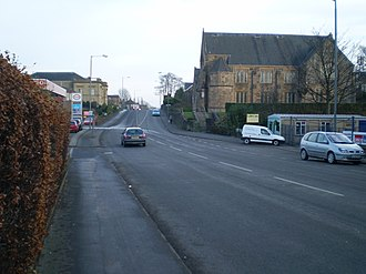 "Larbert - The point at which Larbert merges into Stenhousemuir is known as ""The Brae"". The photograph is taken looking east into Stenhousemuir, with Larbert West Church in the foreground."