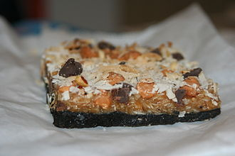Dessert bar - A bar made of coconut shavings, caramel, chocolate and butterscotch chips, almond pieces, and an Oreo cookie crust