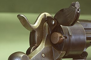 Pinfire cartridge - Detail of a Lefaucheux M1858 pistol. Notice the pin protruding from the cartridge.