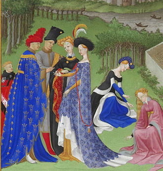 1400–1500 in European fashion - Full-bodied houppelandes with voluminous sleeves worn with elaborate headdresses are characteristic of the earlier 15th century. Detail from Très Riches Heures du Duc de Berry.