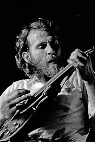 Levon Helm - Helm playing mandolin in 1971