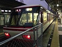 Limited Express bounding for Nishitetsu-Fukuoka (Tenjin) Station before departure in Omuta Station (Nishitetsu).JPG