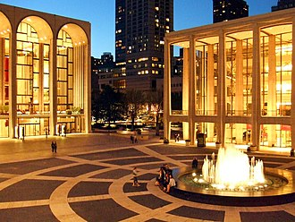 Lincoln Center for the Performing Arts - The Metropolitan Opera House (left) and David Geffen Hall (right) and the Charles H. Revson Fountain at twilight
