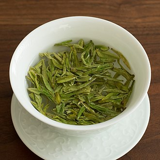 Tea - Longjing green tea being infused in a gaiwan