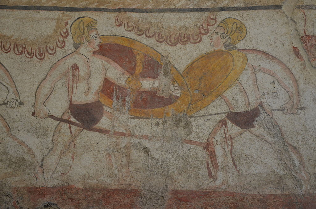 1024px-Lucanian_fresco_tomb_painting_of_2_warriors_fighting%2C_3rd_century_BC%2C_Paestum_Archaeological_Museum_%2814603089585%29.jpg