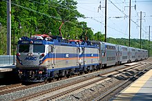 Silver locomotives with blue and orange striping