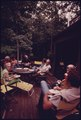 MCCLURE CREEK AREA RESIDENTS GATHER FOR SUPPER ON THE PATIO OF THE DOUG MCCLURE HOME SIX MILES SOUTHEAST OF UNICOI... - NARA - 557779.tif