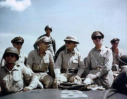American military officers off Leyte Island in the Philippines, October 1944: Lieutenant General George Kenney, Lieutenant General Richard K. Sutherland, President Sergio Osmena, General Douglas MacArthur MacArthur, Kenney and Sutherland.jpg